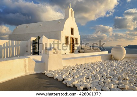 White church during sunset in Santorini, Greece - stock photo