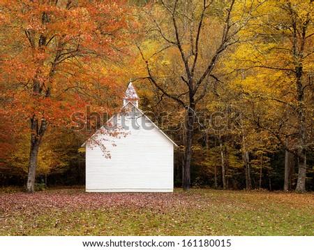 white church in autumn - stock photo