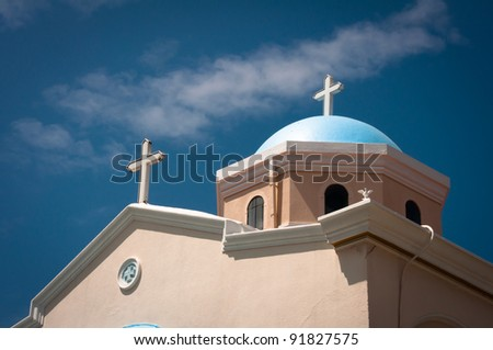 White church in Kos town with blue roof - stock photo