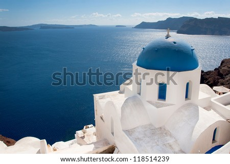 White church in Oia village on Santorini (Greece) with sea view