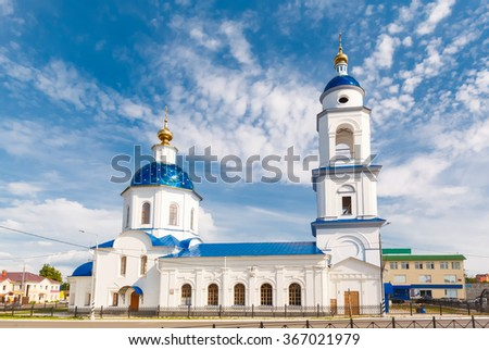 white church on a background of blue sky in the town of Maloyaroslavets, Moscow region - stock photo