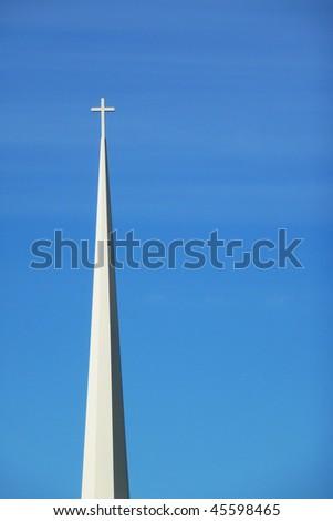 White church spire against blue sky - stock photo