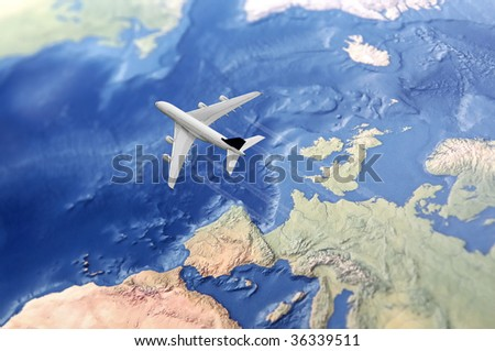 White Civil Airplane over the Atlantic ocean flying from Europe to the USA - stock photo