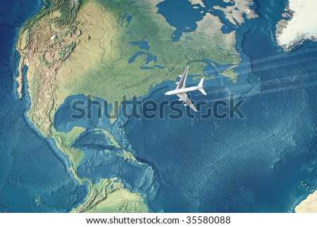White Civil Airplane over the Atlantic ocean flying to the USA - stock photo
