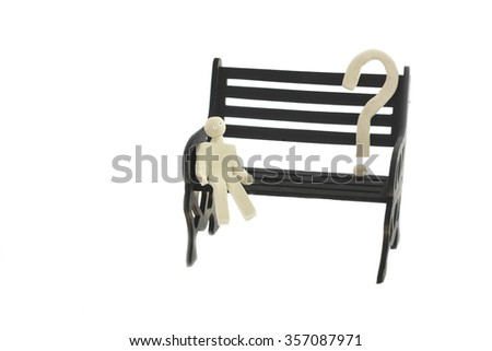 white clay man sitting on the black bench, looking at a giant question mark - stock photo