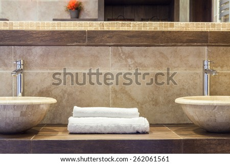 White clean folded towels on marble shelf - stock photo
