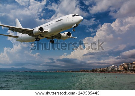 White clean plane landing in sunny day - stock photo