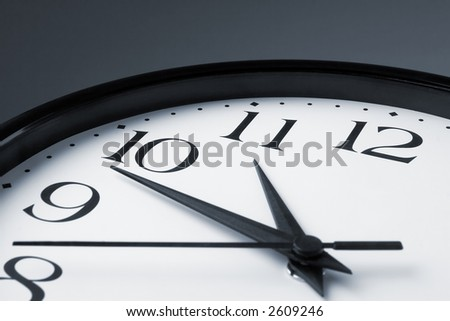 White clock face with black border on gray background - stock photo