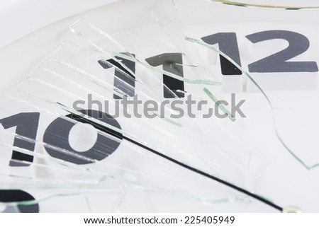 White clock is broken glass isolated on white background - stock photo