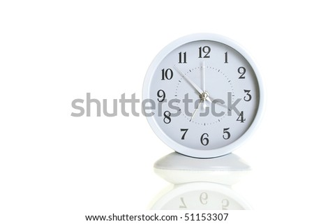 white clock on a white background