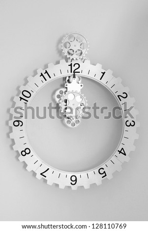 White clock with gears on white background - stock photo