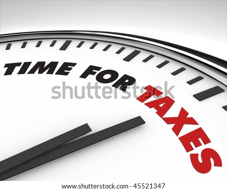 White clock with words Time for Taxes on its face - stock photo