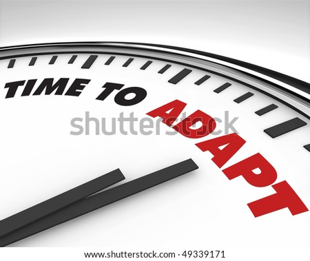 White clock with words Time to Adapt on its face - stock photo