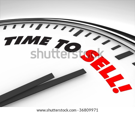 White clock with words Time to Sell on its face - stock photo