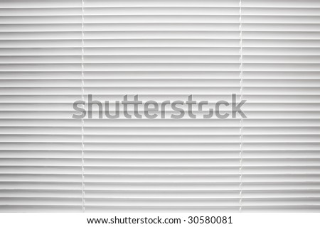 White closed jalousie at day illumination - stock photo