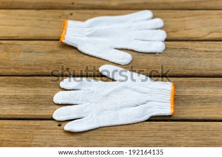 White cloth glove on deck