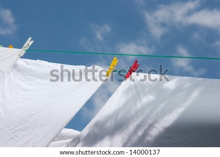 White clothes drying on the rope - stock photo
