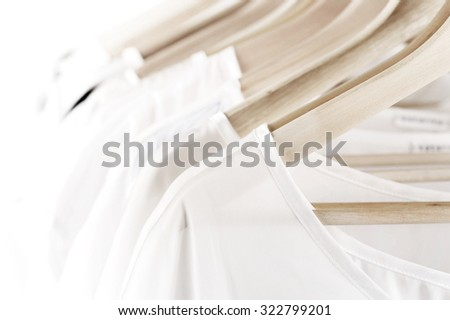 white clothes on hangers close up - stock photo