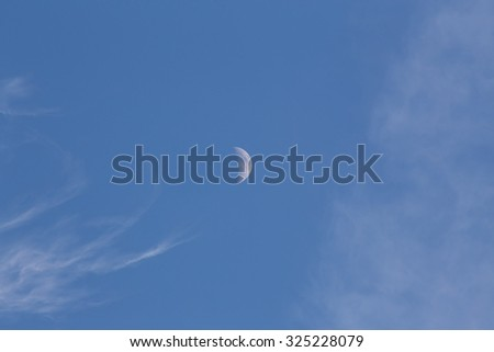 White cloud nad moon in blue sky - stock photo