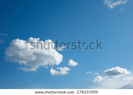 white cloud stands out against  blue sky