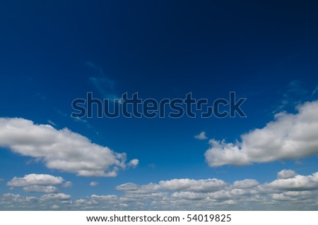 White Clouds an a dramatic blue sky - stock photo