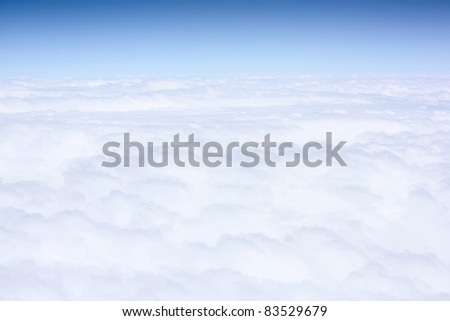 White clouds and blue sky. View from plane - stock photo