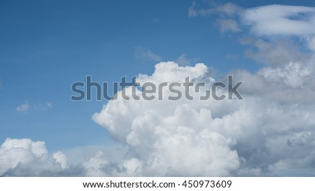 White clouds and blue sky with plane in background - stock photo