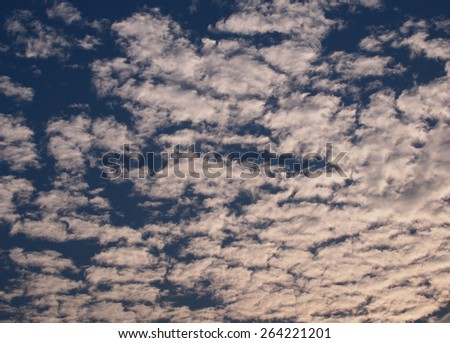 white clouds and deep blue sky on a sunny day as backdrop background picture - stock photo