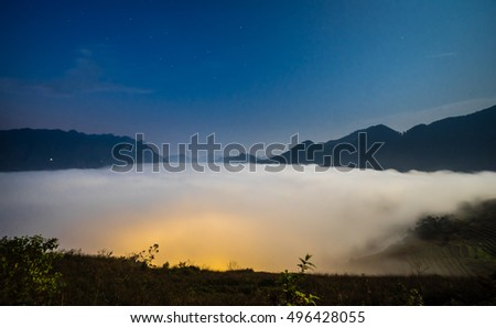 White clouds appear at sunrise in the valley in Northwest Vietnam
