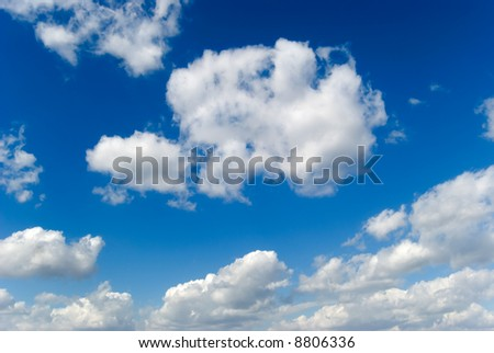 White clouds are photographed on a blue background
