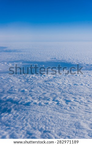 White clouds.  Beautiful blue sky sea,  a view from an aeroplane above the clouds