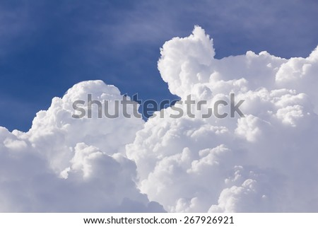 White clouds closeup in blue sky before rain - stock photo