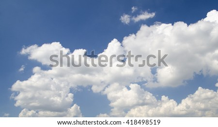 White clouds flying in deep blue summer sky - stock photo