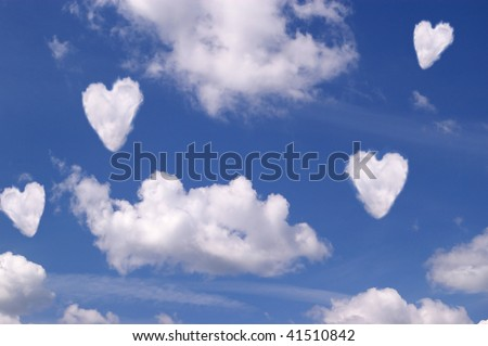 White clouds hearts on blue sky - stock photo