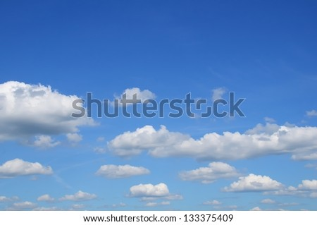 White clouds in a blue sky - stock photo