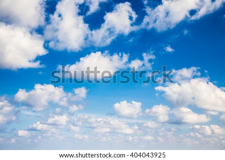 White clouds in blue sky wide angle view - stock photo