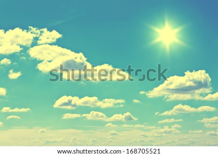 White clouds in blue summer sky background - stock photo