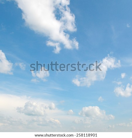 white clouds on a blue sky background - stock photo