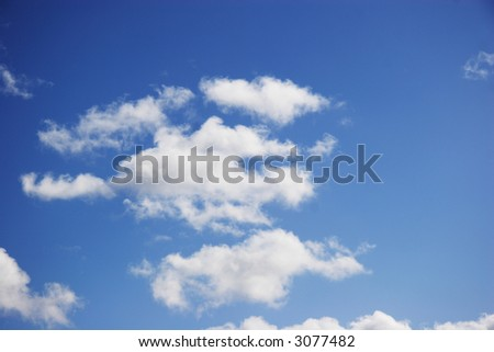 White clouds on a fine day with blue sky - stock photo