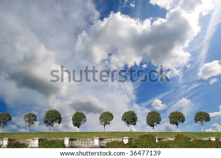 white clouds on blue sky in Petergof - stock photo