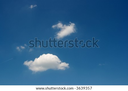 White clouds on deep blue sky - stock photo