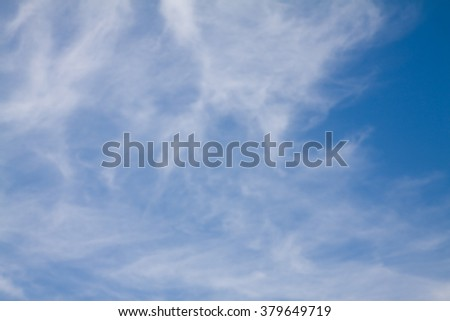 White clouds on the blue sky background.
