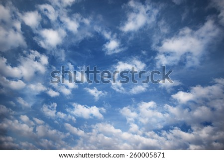 White clouds on the spring blue sky.  - stock photo