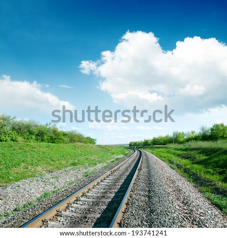 white clouds over railroad