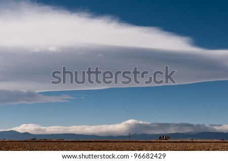 White Clouds over The Colorado Plains and Foothills - stock photo
