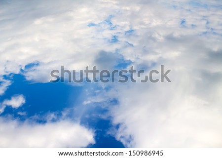 White clouds taken form above while flying in a plane. - stock photo