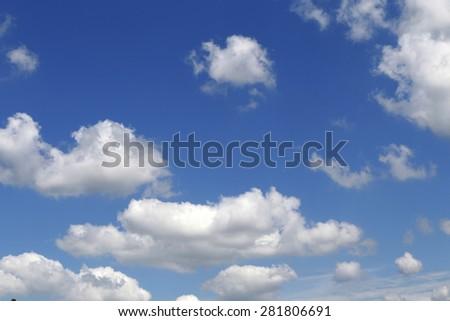 white clouds with blue sky in background - stock photo