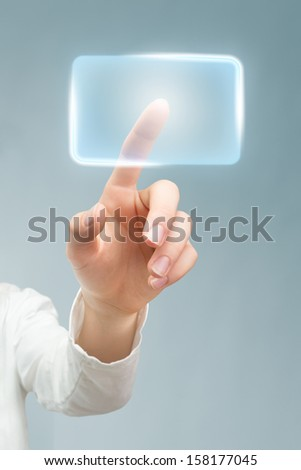 White-coated hand pushing blue virtual button. - stock photo
