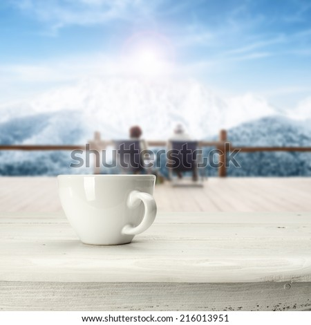 white coffee and white table in winter time  - stock photo