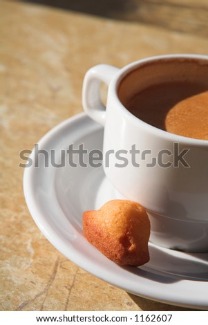 White Coffee cup and biscuit - Shallow DOF